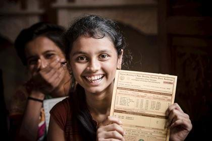 Girl with certificate, India