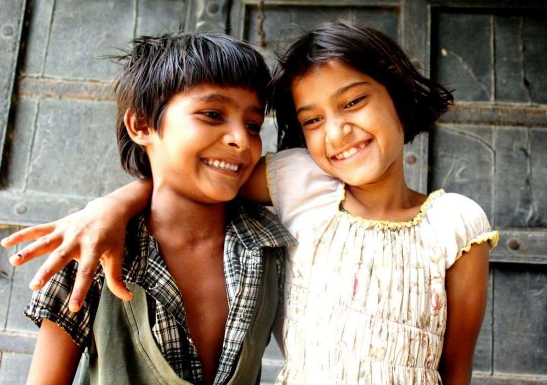 young boy and young girl giggling, India