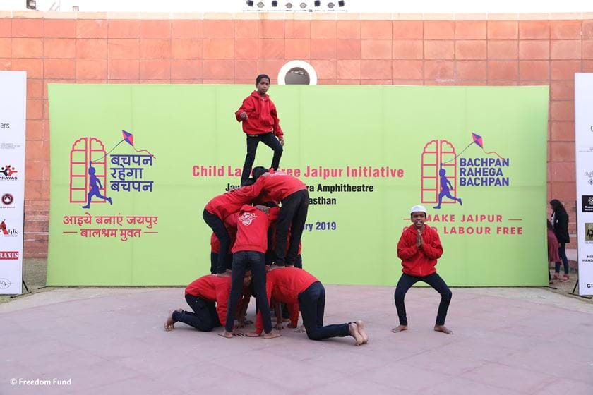 a group of boys performing at launch of child labour free Jaipur event
